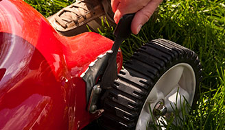Close-up of red lawn mower wheel