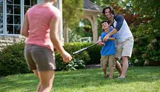Family spending time on lawn - How a Green Lawn Can Keep Your Family Healthy