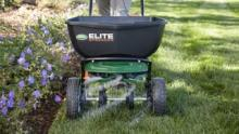 Which Spreader: Scotts® Elite Spreader in use in the yard thumbnail