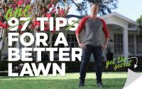 97 Tips For A Better Lawn: A man standing proud over his healthy green lawn.