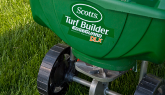 A Scotts fertilizer spreader in use.