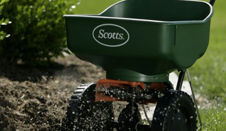 A lawn spreader in use