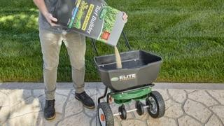filling Elite Spreader with Triple Action