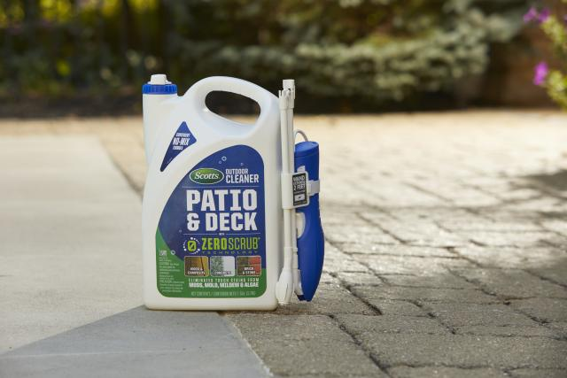 Scotts® Outdoor Cleaner Patio & Deck With ZeroScrub™ Technology sitting on the ground.