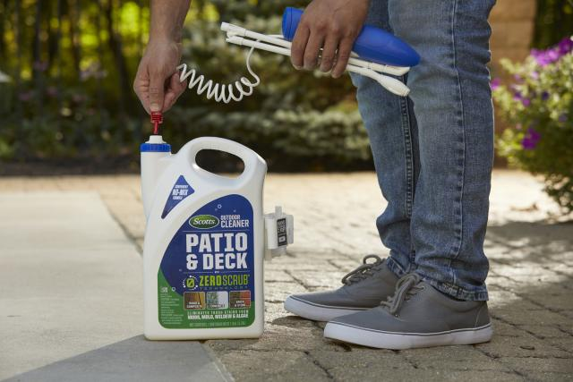 Man prepping Scotts® Outdoor Cleaner Patio & Deck With ZeroScrub™ Technology for use.