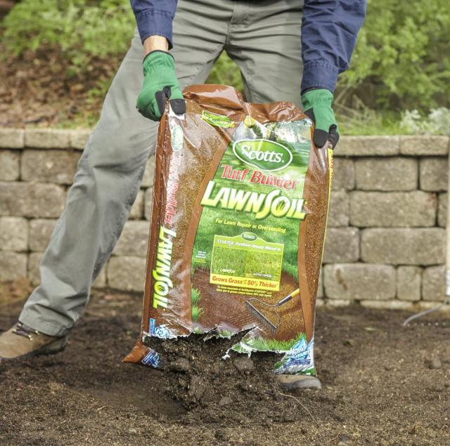 pouring mulch into garden