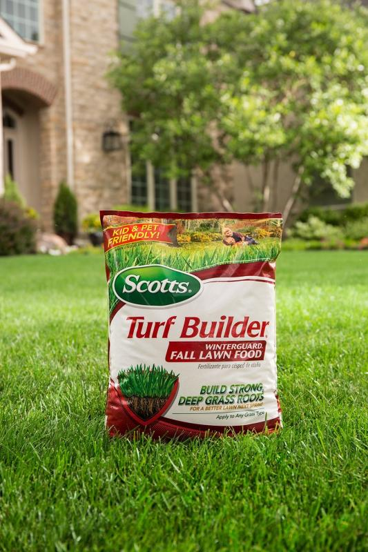 Pack of Scotts® Turf Builder® WinterGuard® Fall Lawn Food sitting in grass
