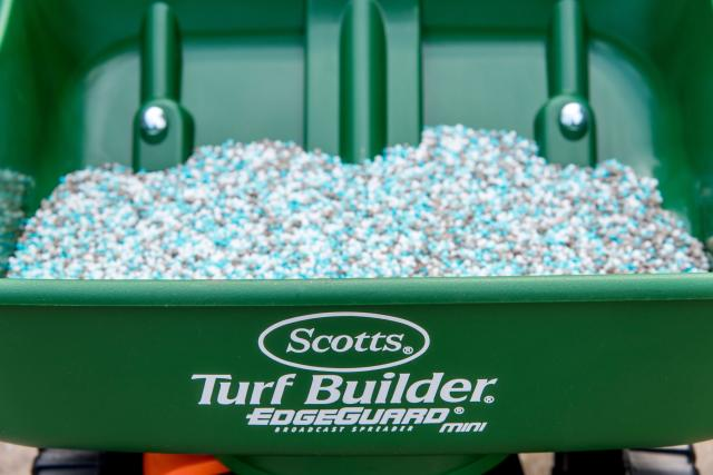 Product granules in green spreader